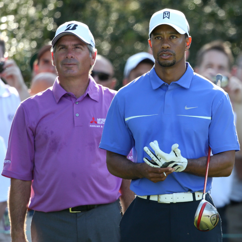 Tiger Woods and Fred Couples trade shots